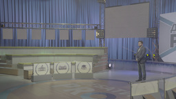 Male TV presenter in an empty TV Studio before a live Footage