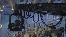 The camera moves through the air while recording a TV show Footage
