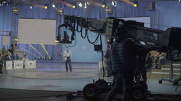 Man controls TV a crane with a camera while recording a TV show Footage
