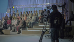The cameraman and the audience during the live broadcast Footage