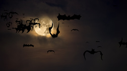 Bats flying against Halloween moon Footage