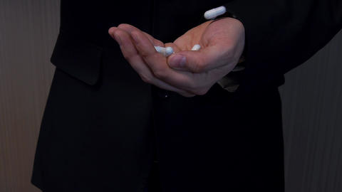 Man in suit offers white tablets Footage