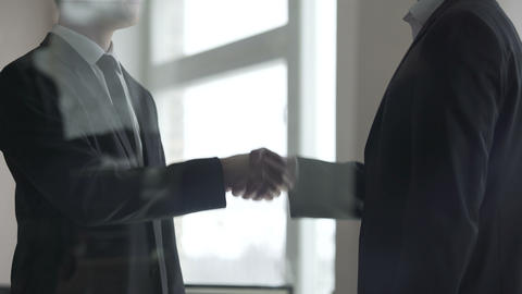 Business partners confirming deal with firm handshake, teamwork, partnership Footage