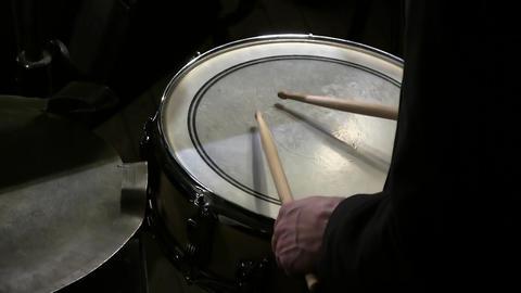 Drum sticks hit on the snare drum in black background Footage
