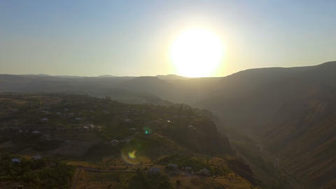Aerial panoramic view of cozy Armenian village at sunset, mountain landscape Footage