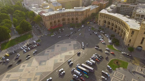 Automobiles driving on Republic square in Yerevan, aerial view of main street Live Action