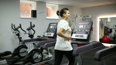 Girl loses weight on a treadmill Live Action