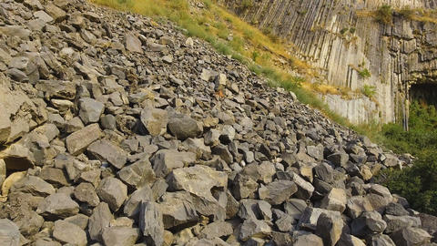 Rock slides and stones scattered over hills, risk of mudflow, geology science Live Action