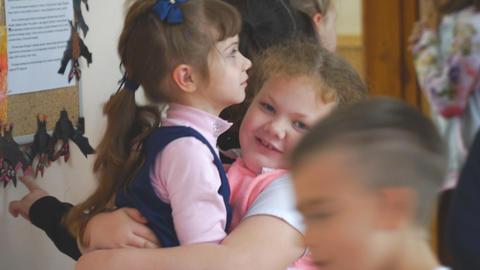 School children at recess in the hallway 영상물