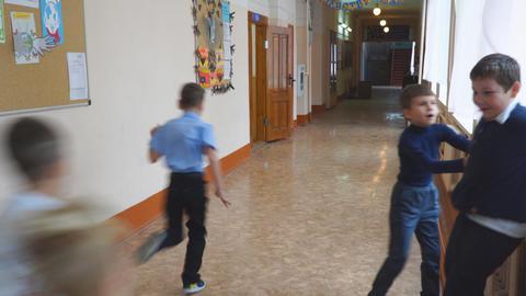 School children at recess in the hallway Live Action
