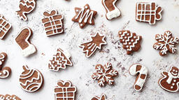 Composition of delicious gingerbread cookies shaped in various Christmas symbols Footage