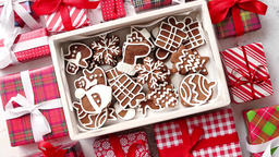 Delicious fresh Christmas decorated gingerbread cookies placed in wooden crate Footage