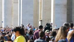 Slow motion of Pope Francis at St Peter's square riding popemobile, people Footage