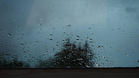 Raindrops on window in a very cold and dark day Footage