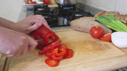 Woman slicing red bell pepper 영상물
