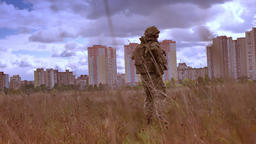 Shooting from the back, isolated male in army uniform and camouflage look Footage