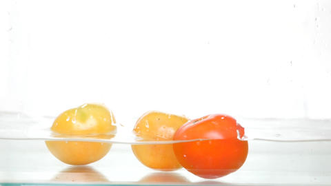 Falling Tomatoes Rotating On White Background Selling Stock Video Footage