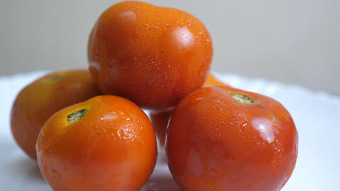 Ripe tomatoes Drops of water dripping from above Stock Video Footage