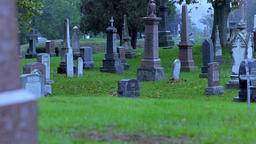 Grave stones, headstones, and monuments at a cemetery. Eerie background of an Footage