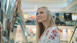 Amazed woman in shopping center Footage