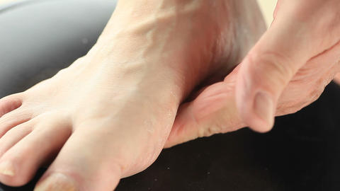 Senior man massages the arch on his foot Footage
