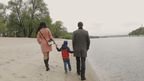 Family walks on the river bank in warm weather Footage