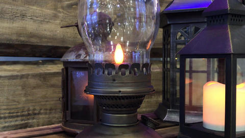 Glowing Christmas lantern in a wooden place Footage