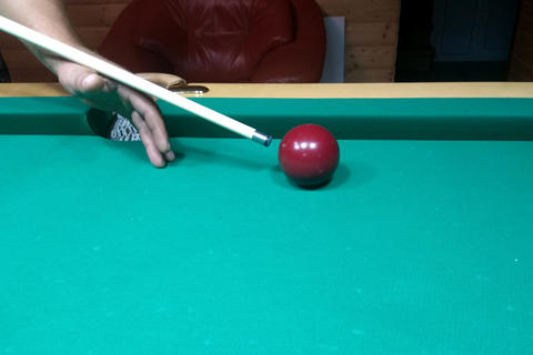 Billiard table and one billiard table with a cue Photo