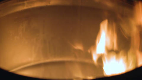 Close-up of fire burning in barrel, source of heat and light for homeless people ビデオ
