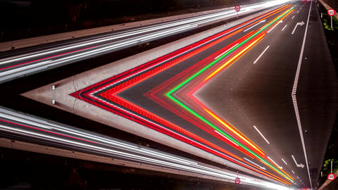 Fast car lights in the highway, loop-ready reflected time lapse Live Action