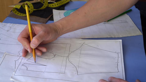 Hand Of Fashion Designer Drawing Pattern At Paper In Her Studio Footage
