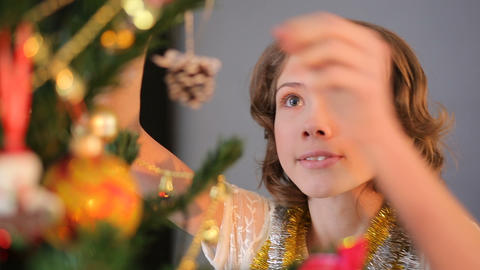 Little lady decorating Christmas tree, winter holidays and traditions, childhood Footage