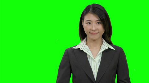 Asian female businesswoman showing thumbs up on Green Screen Live影片