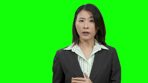 Asian female anchor woman on Green Screen Live影片