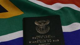Throwing multiple RSA passport on SA flag Live Action