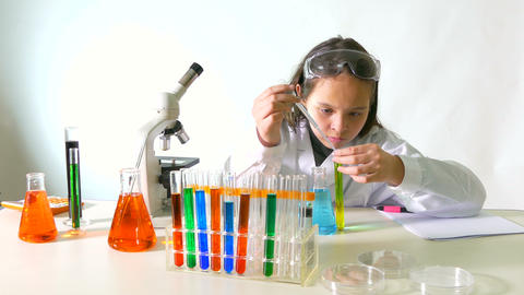 Young scientist transfers with pipette Live Action