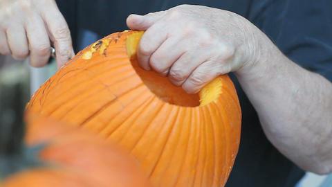 Man begins carving a Halloween jack o lantern Footage