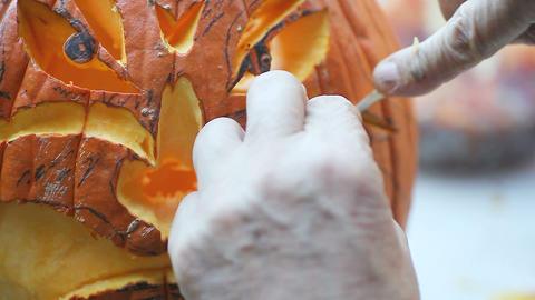 Closeup of Halloween pumpkin carving Footage