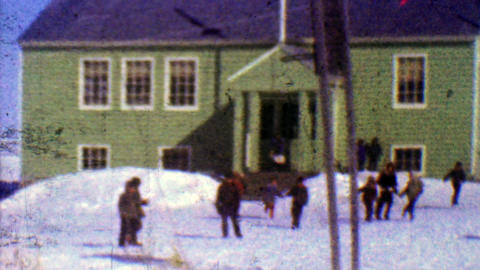 1957: One room schoolhouse kids play outside winter cold sunny day Footage