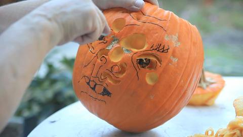 Halloween pumpkin face carving Footage
