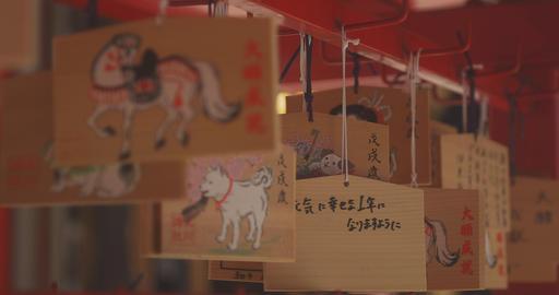 Votive tablet at Hikawa shrine in Tokyo medium shot back rack focus 4K Live Action
