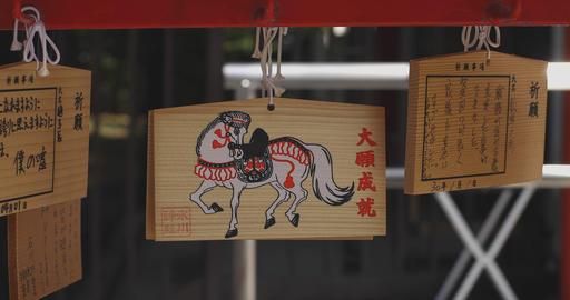 Votive tablets at Hikawa shrine in Tokyo close up right slide shot 4K ライブ動画
