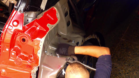 Mechanic Working on Car Frame Footage