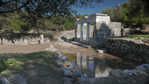 Facade of the ancient temple with columns reflection in the water, Kaunos 영상물