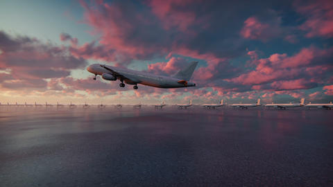 Passenger plane takes off at sunset background in slow motion CG動画素材