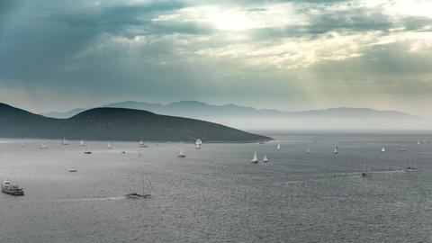 Sea scenery with boats sailing in a cloudy day with the sun rays bursting Footage