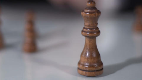 Male hand moving queen in chess game, fortune and corporation strategy, closeup Live Action