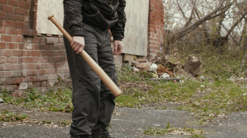 Masked bandit with baseball bat at abandoned place Footage