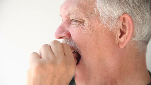 Senior man flossing his teeth Live Action