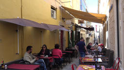 Malta Valletta seats of cafes & restaurants outside in small old town alley GIF